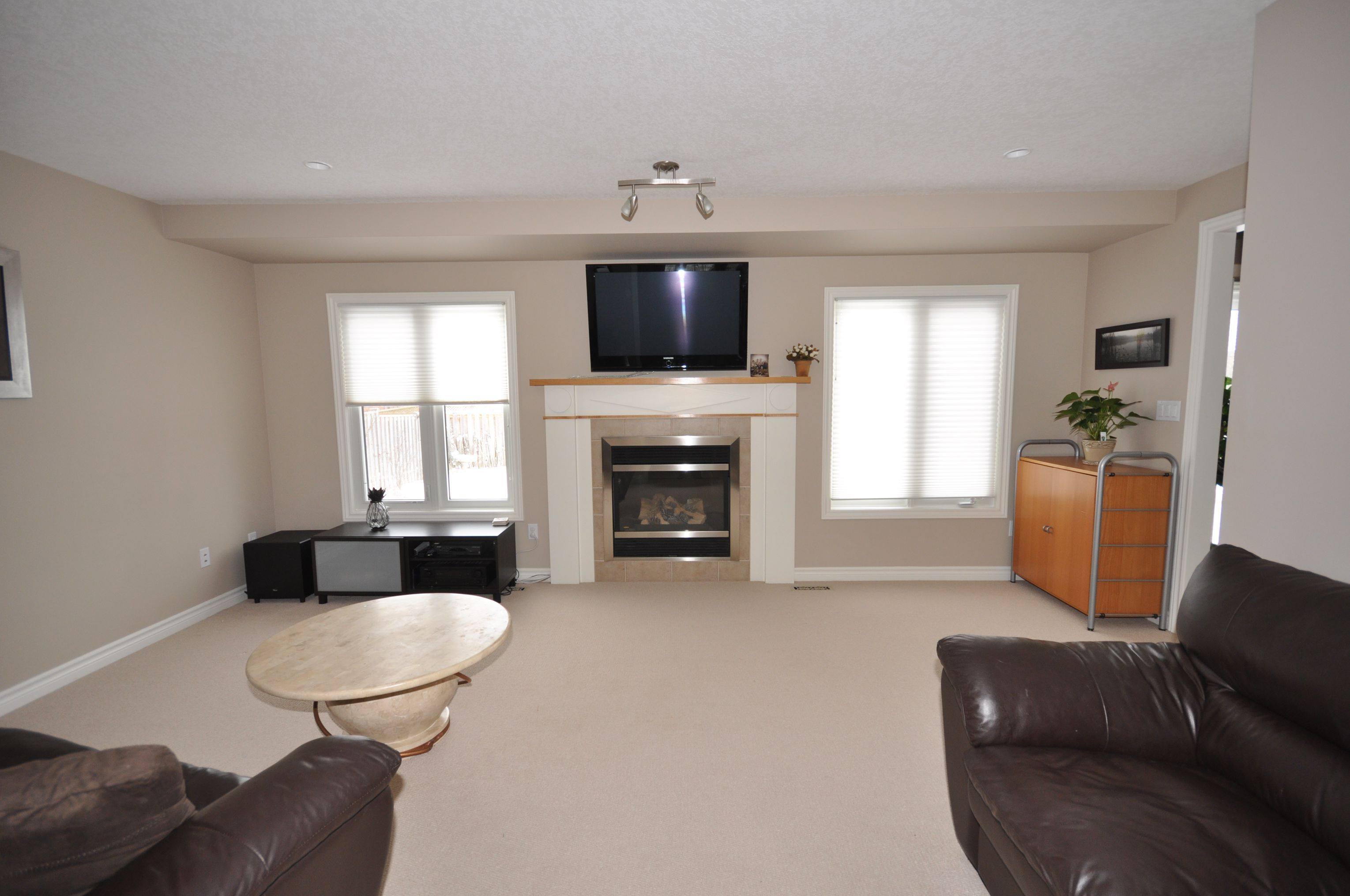 Spacious great room with gas fireplace & bright sunny windows