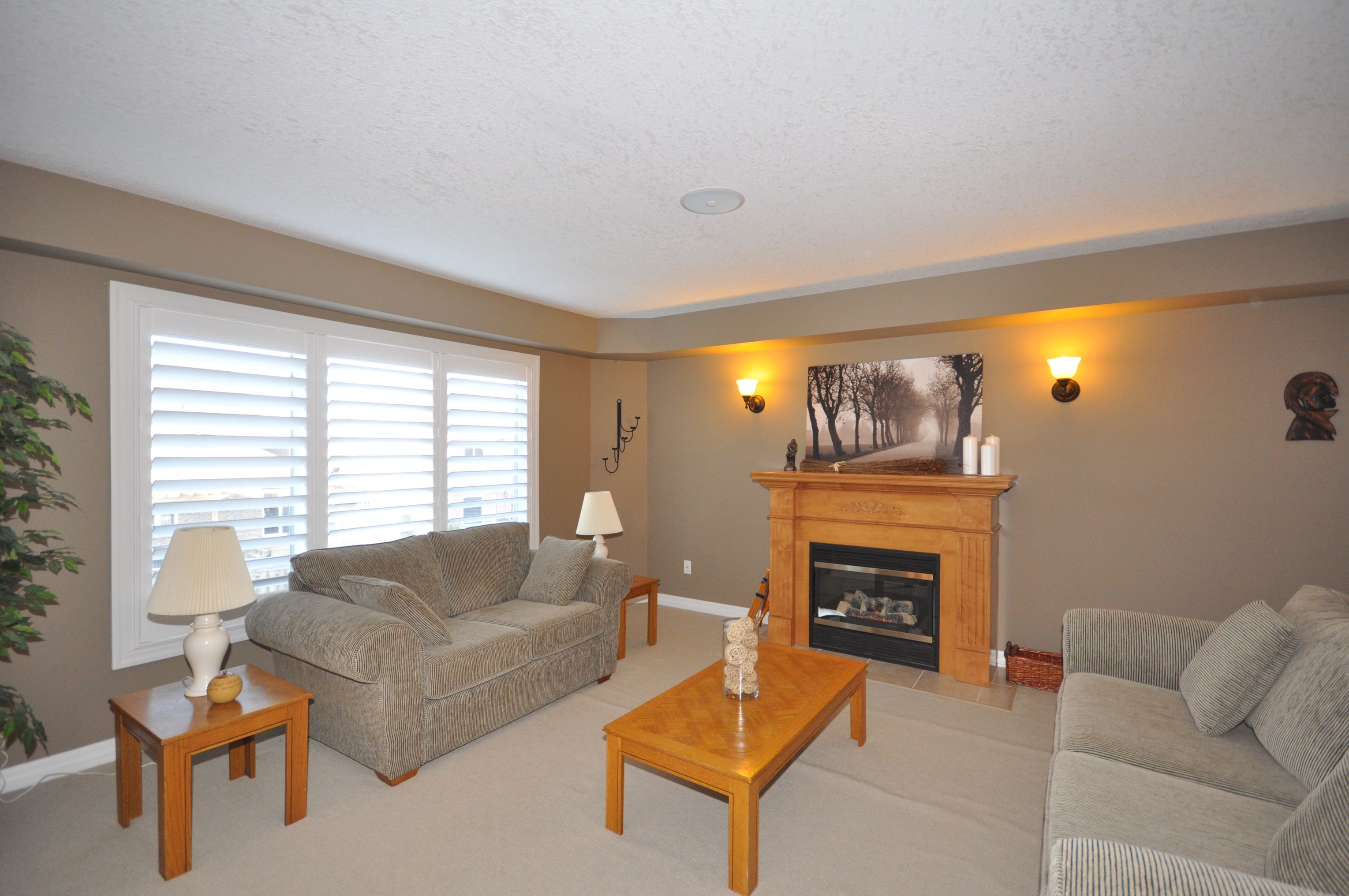 Open concept main floor great room with cozy gas fireplace