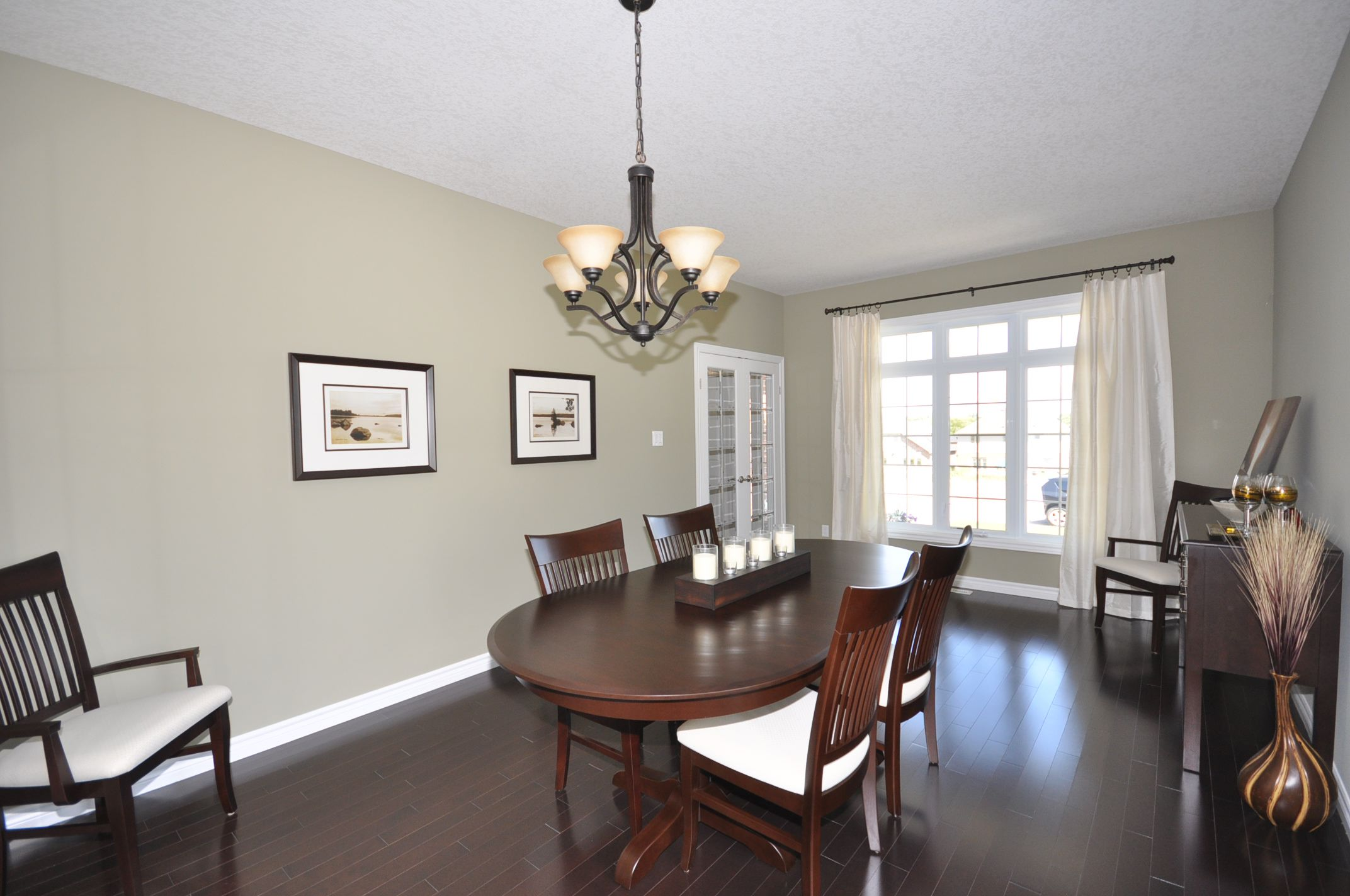 Living/Dining room combo with gleaming hardwood floors
