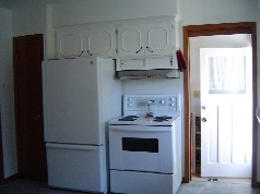 The cupboards have all been painted white and its eat in size!