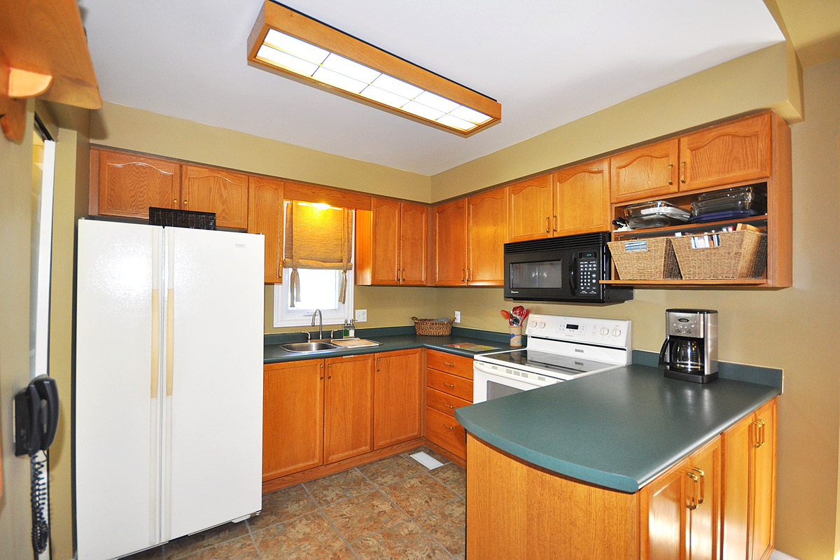 Eat in Kitchen has pantry & overlooks spacious Family Room