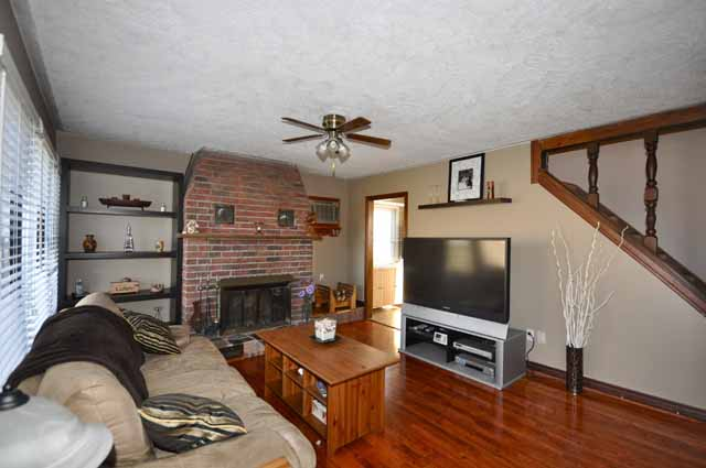 Spacious Living Room with newer laminate flooring