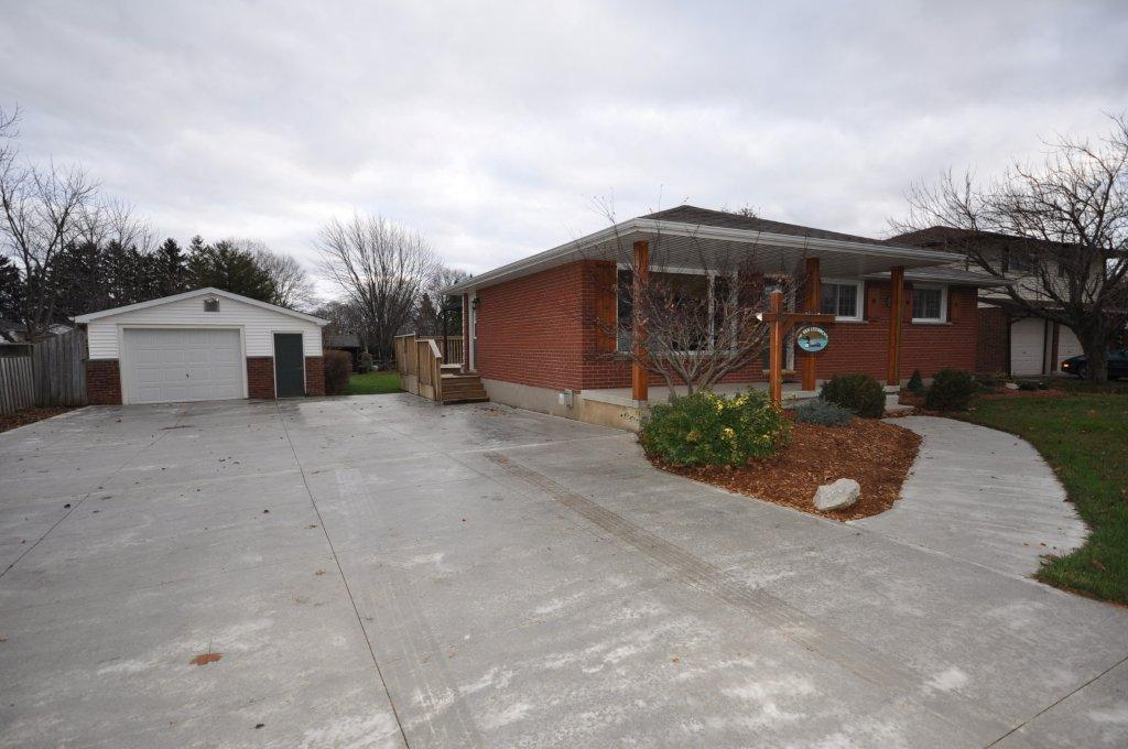 Recent addition of a huge concrete driveway & front walkway