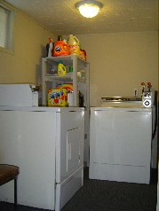 Coin operated washer & dryer located in the lower level