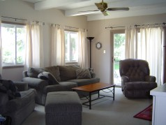 Sunken main floor family room with built in bookshelves, large windows & patio doors to the pool