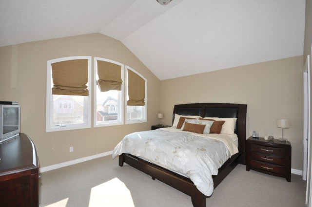 Master Bedroom With Pallidum Windows & Cathedral Ceiling