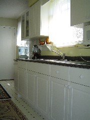 Main floor kitchen with extra cabinetry