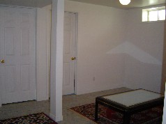 Lower level has a seperate side entrance, 2 bedrooms with large windows and a living area