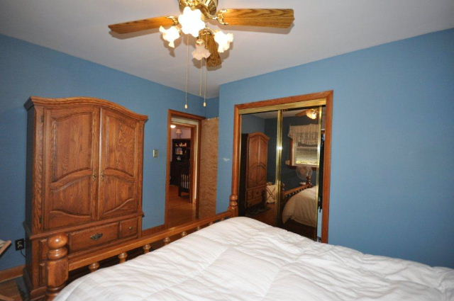 Convenient Mirrored Closet Doors in Master Bedroom