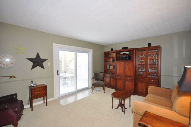 Bright Family Room with doors to deck