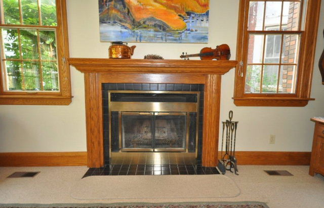 Close up of family room oak fireplace