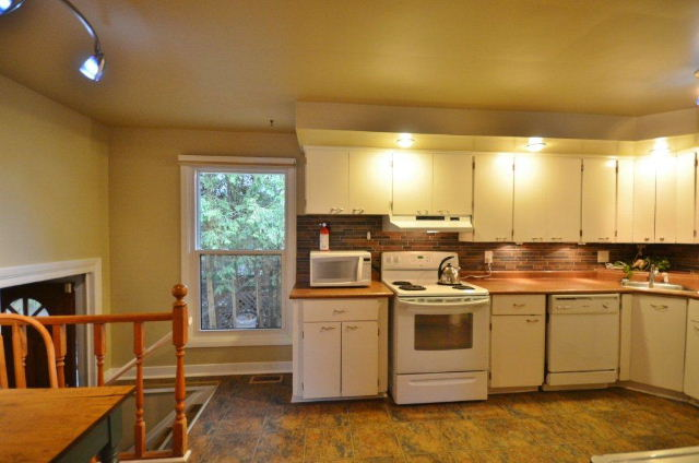 Kitchen with access to side yard sundeck
