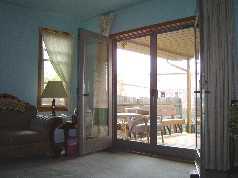 Newer double doors leading to the covered deck off the master bedroom