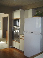 The kitchen offers a built in gas stove top, oven and a dishwasher too plus a built in desk