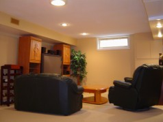 Large bright family room that is perfect for your home theatre located in the lower level