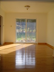 Dining room also has new hardwood flooring, trim plus updated sliding doors to large backyard