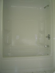 Main bath has been upgraded with a newer toilet,tub,flooring and light fixtures