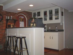 Lots of room for the whole family this Christmas season to enjoy your updated wet bar & family room