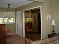 The master has hardwood under the carpeting and double mirrored his plus a linen closet and her closet doors