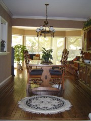 Formal dining area with newer plank flooring and lovely crown moldings