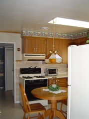 Kitchen has gas hookup for your stove, a sunny skylite and window that overlooks the yard and an attractive french door to the dining room