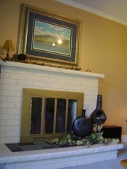 Family room enjoys a toasty wood burning fireplace and warm berber carpeting