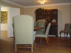 Formal dining room with hardwood floors and crown moldings