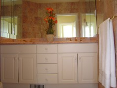 Marble ensuite with double sinks, and a large glass shower