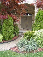Gorgeous perennial garden leading to the double front doors