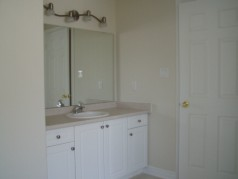 Ceramic flooring and large vanity in ensuite.