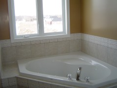 Corner soaker tub and separate shower in ensuite.