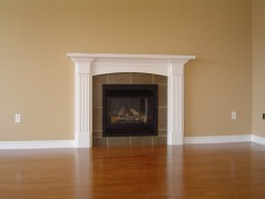 Spacious family room with gas fireplace and more hardwood.