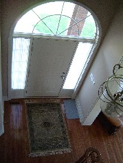 Spacious front foyer with gleaming hardwood floors