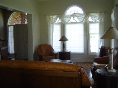 Living and Dining Room have large sunny windows, upgraded trim & mouldings