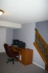 Lower level recreation room with space for your office