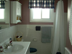 Spacious updated bathroom with large window