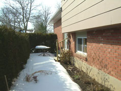 Secluded patio with perennial garden at
