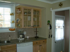 Large, bright and sunny eat in kitchen with new maple cabinetry