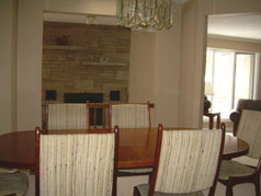 Dining room overlooks family room with floor to ceiling fireplace