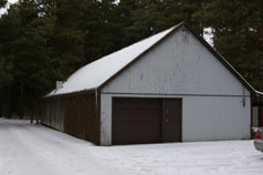 Front view of workshop with newer insulated garage door