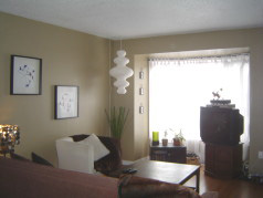 Large living room with new sunny bay window