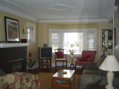 Firelit living room with large sunny window