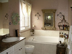 Master ensuite with whirlpool soaker tub and his & her basins