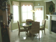 Sun drenched eat-in area with gas fireplace