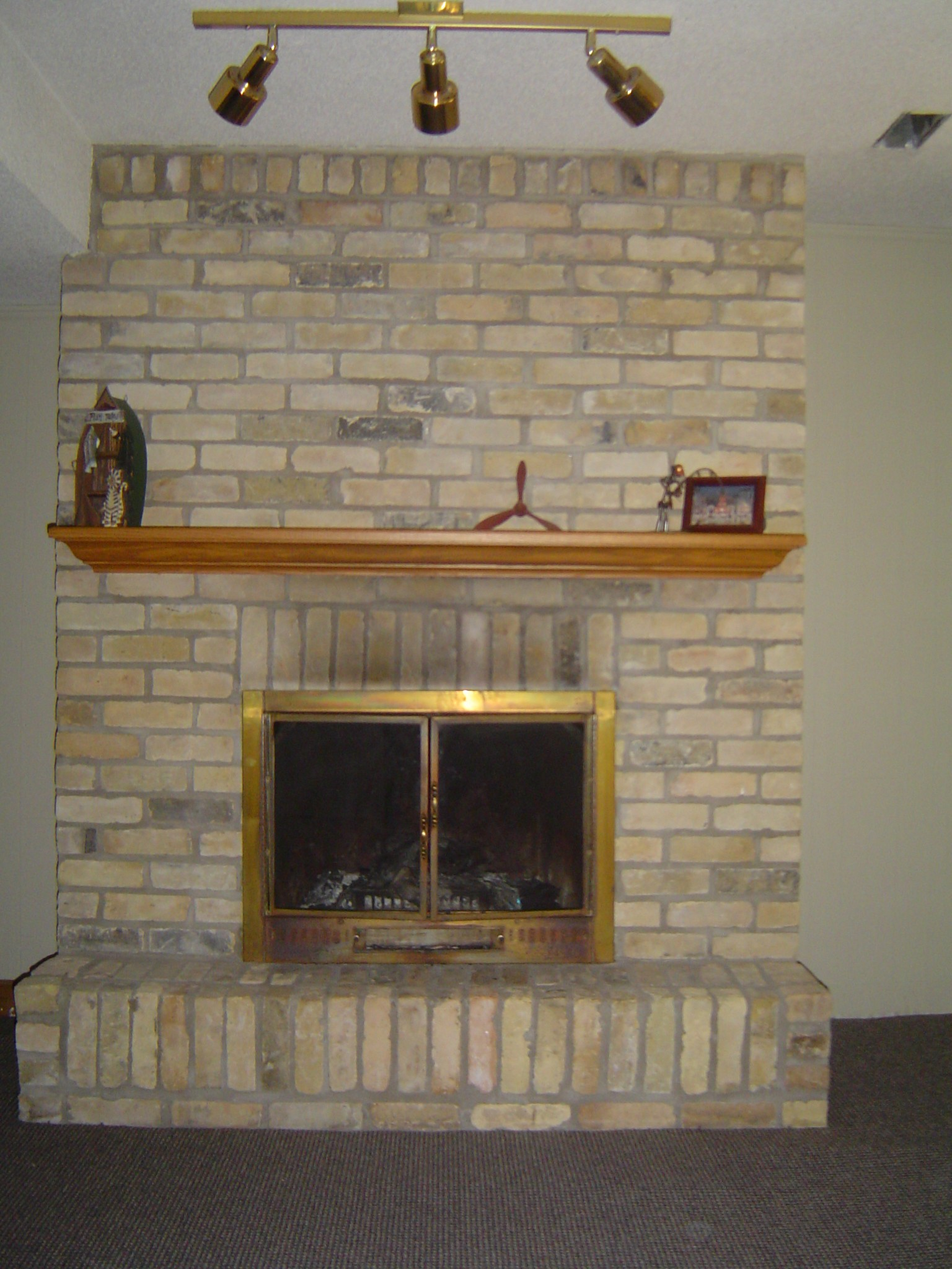 Floor to ceiling reclaimed yellow brick fireplace